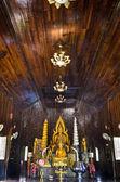 Buddha statue in chapel — Stock Photo