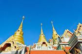 Golden pinnacle of thai temple — Stock Photo
