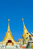 Golden pinnacle of thai temple — Stock Photo