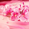 Pink orchids, necklace and beads — Stock Photo