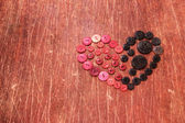 Heart from vintage red and black buttons — Stock Photo