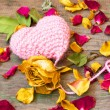 Knitted pink valentine's heart on a wooden background  — Stock Photo