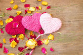 Knitted valentine's hearts on a wooden background — Stock Photo
