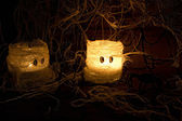 Home made halloween candles, spiders and web — Stock Photo