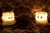 Home made halloween candles and spiders — Stock Photo