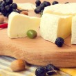 Stock Photo: Sliced camembert cheese on wooden board