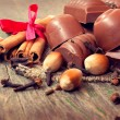 Stock Photo: Yummy chocolate candies, cinnamon, nuts