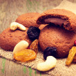 Yummy biscuits with chocolate filling, raisins, nuts — Stockfoto #32699413
