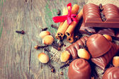 Tasty chocolate candies, cinnamon, nuts — Stock Photo