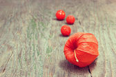 Cape gooseberries on a wooden background — Stock Photo