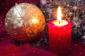 Red candle and christmas ball close up — Stock Photo