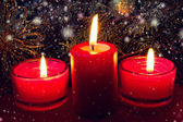 Red christmas candles close up — Stock Photo