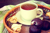 Cup of tea and chocolate cakes — Stock Photo
