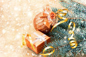 Beautiful golden ball, gift box and christmas tree branches — Stok fotoğraf