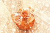 Beautiful golden christmas ball on a shiny background — Stock Photo