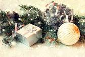 Shiny silver gift box and christmas ball — Stock Photo