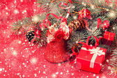 Red shiny christmas bell and gift box — Foto Stock