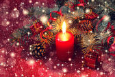 Red christmas candle on a shiny background — Stock Photo