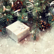 Silver gift box on a sparkling christmas background  — Stok fotoğraf