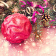 Christmas ball on a sparkling pink background  — Stock Photo