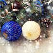 White and blue christmas balls on a shiny background — Stock Photo