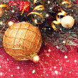 Golden ball and decorated christmas tree twigs  — Stock Photo
