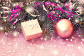 Pink gift box and christmas decorations — Stock Photo