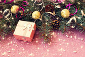 Cute pink box and other christmas decorations — Stock Photo