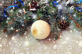 White christmas ball on a shiny background — Stockfoto