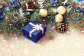 Deep blue gift box on a sparkling christmas background — Stock Photo