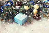 Cute blue gift box on a sparkling christmas background — Stock Photo