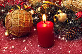 Red candle and christmas golden ball — Stock Photo