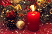 Red candle and christmas decorations and toys — Stock Photo