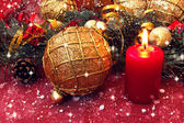 Red candle and other christmas decorations — Stock Photo