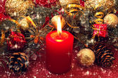 Red candle and other christmas stuff — Stock Photo