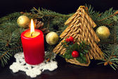 Red candle and vintage christmas decorations — Stock Photo