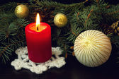 Red candle and white christmas ball — Stock Photo