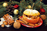 Yummy baked apple, cinnamon sticks, nuts. christmas snack — Stock Photo
