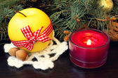 Christmas apple and festive red candle — Stock Photo