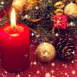 Burning red candle and lovely christmas decorations — Stock Photo