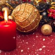 Red candle and lovely christmas decorations — Stock Photo
