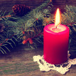 Burning red christmas candle — Stock Photo