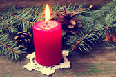 Red christmas candle close up — Stock Photo