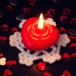 Beautiful red candle in the shape of heart — Stock Photo