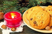 Christmas cookies and red candle close up — Stock Photo