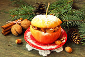 Christmas apple filled with nuts, raisins and honey — Stock Photo