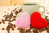 Cup of coffee and knitted valentine's hearts — Stock Photo