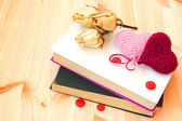 Old vintage books and knitted hearts — Stock Photo