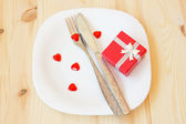 Table setting for valentine's day with gift box — Stock Photo