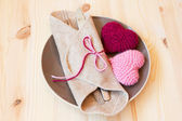 Cute table setting for valentine's day with knitted toys — Stock Photo